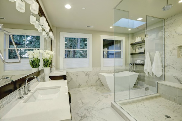 White marble bathroom with open shower