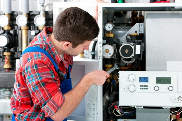 Plumber tinkering inside of a water heater